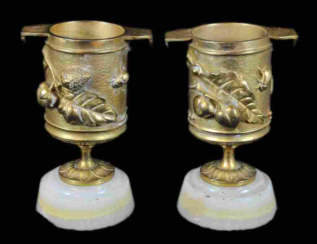 A PAIR OF FRENCH ART NOUVEAU BRONZE DORE' SMALL URNS ON