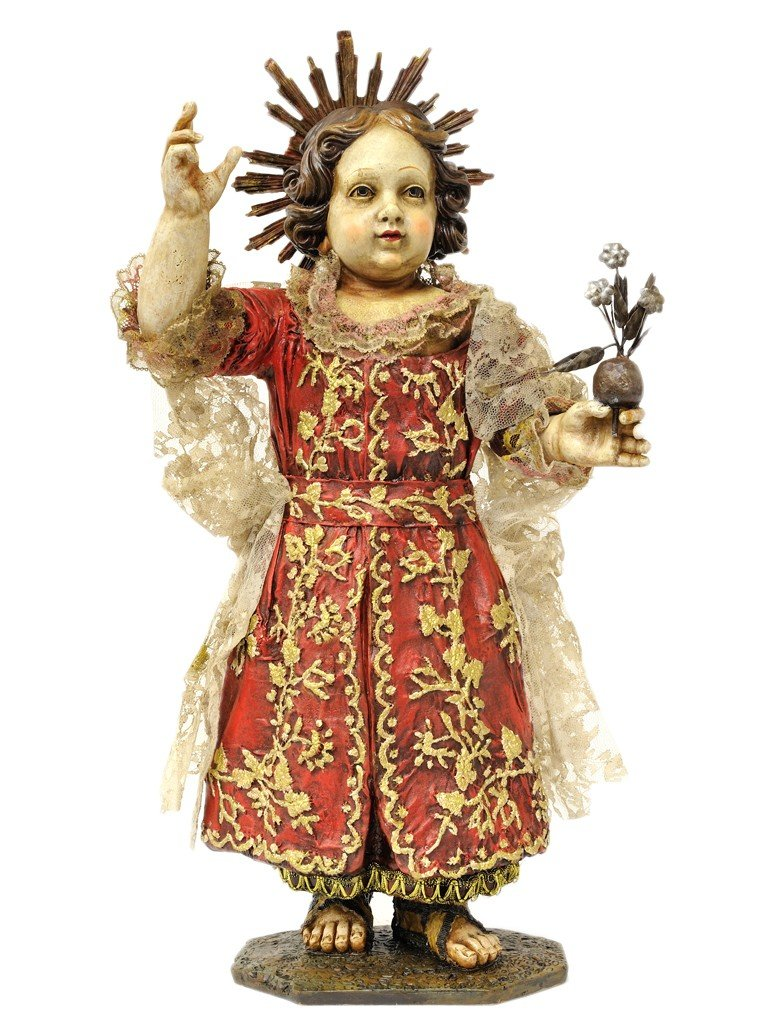 A CAST FIGURE OF JESUS AS A YOUNG BOY