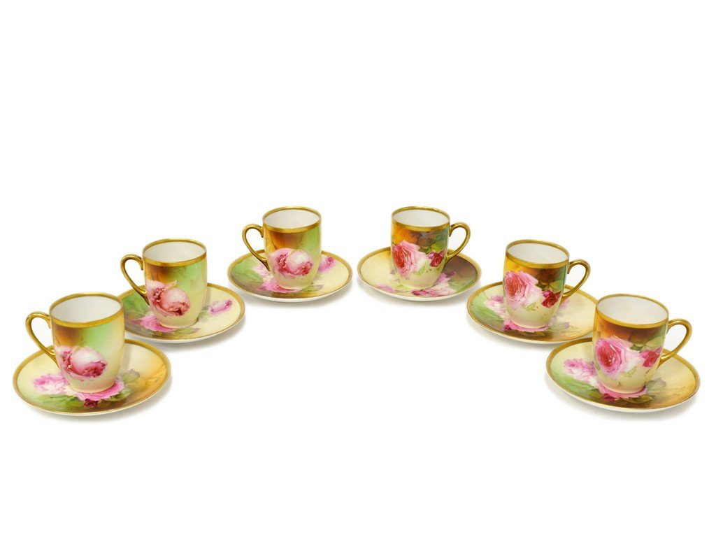 1: A SET OF SIX AUSTRIAN HAND PAINTED TEA CUPS AND SAUC