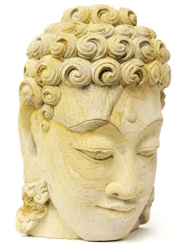 6: A CARVED STONE HEAD OF BUDDHA