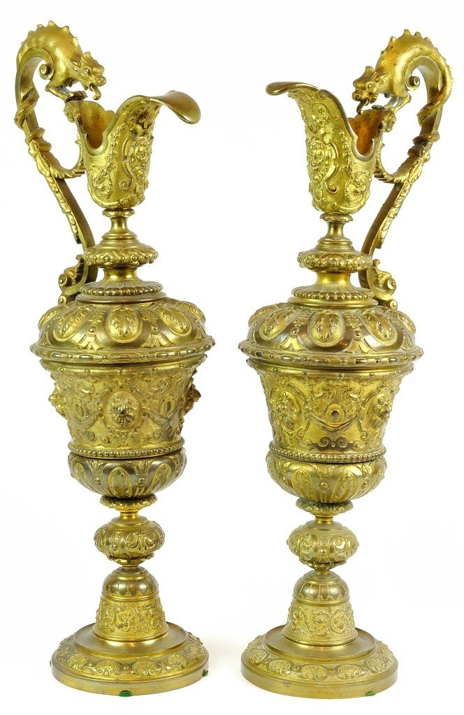 A PAIR OF VICTORIAN DECORATIVE GILT-METAL EWERS Circa 1