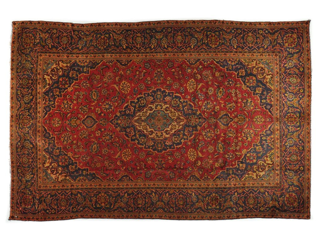 23: A PERSIAN KASHAN RUG 7 ft 5 in x 11 ft 3 in