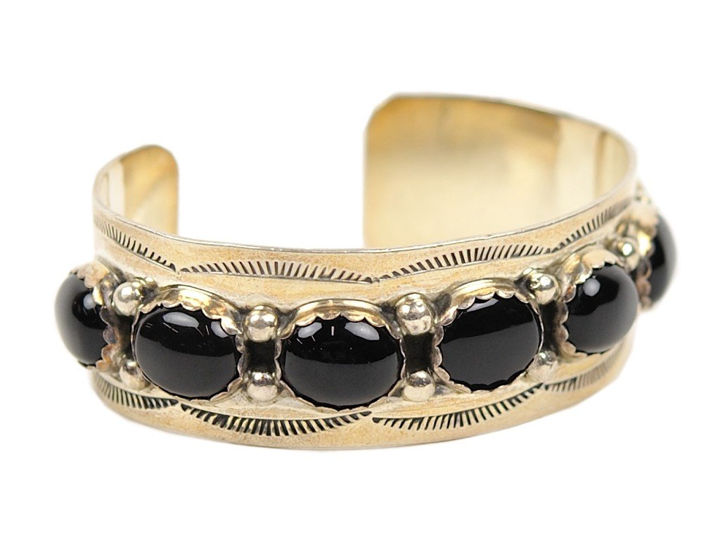 14: A SEVEN STONE BLACK ONYX AND STERLING SILVER CUFF B