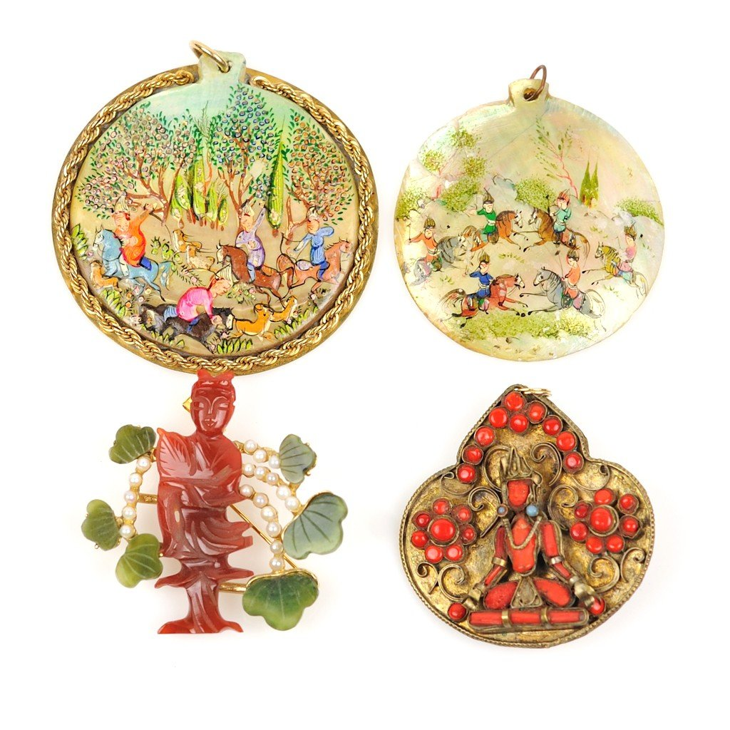 16: A GROUP OF FOUR LARGE PENDANTS including two hand p