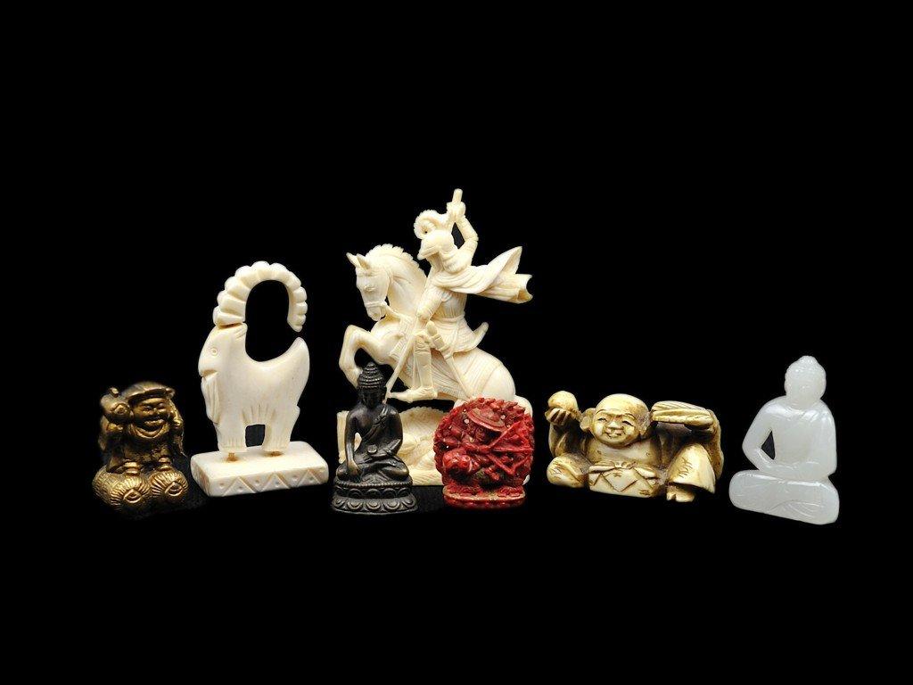 22: A GROUP OF MINIATURE FIGURINES of jade, ivory, bron