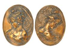 224: A PAIR OF COPPER PLATED IRON OR BRONZE HIGH RELIEF
