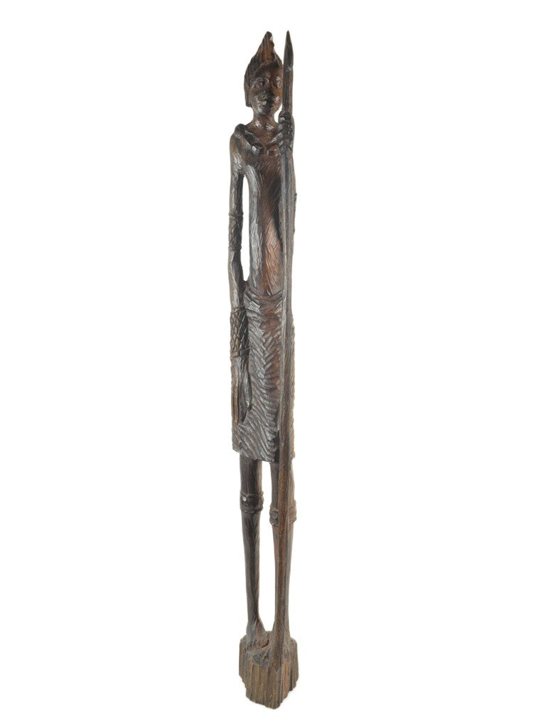 12: A TEAK WOOD AFRICAN TRIBAL CARVED FIGURE WITH STAFF