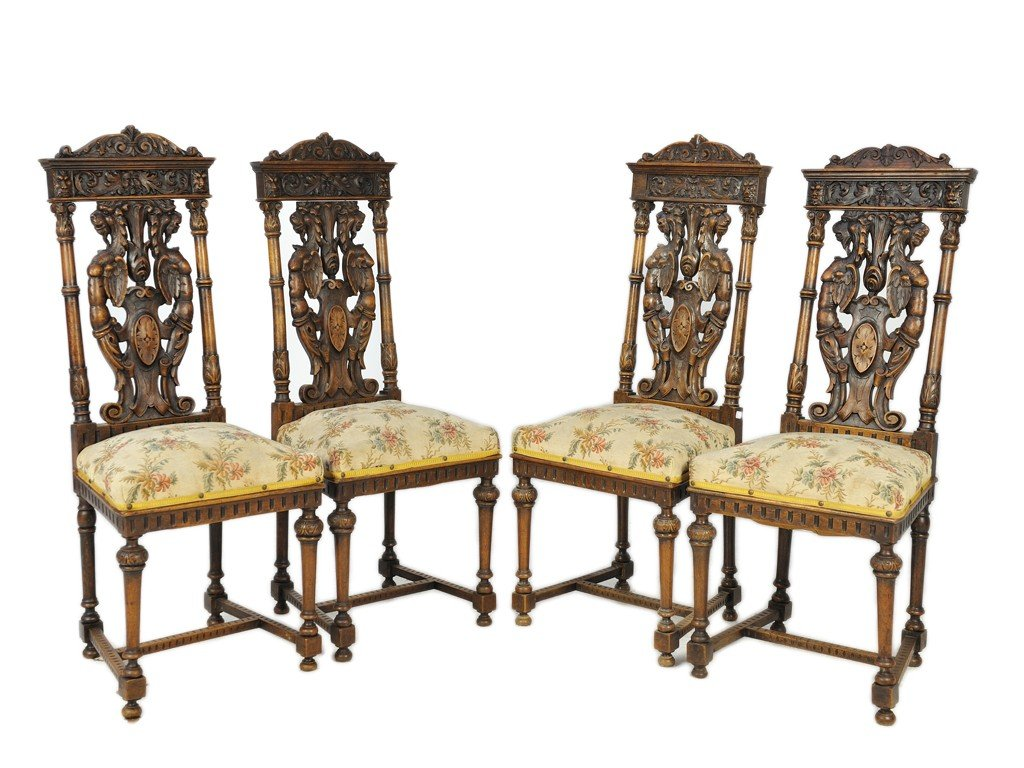 15: A SET OF FOUR LOUIS XIII WALNUT AND UPHOLSTERED CHA