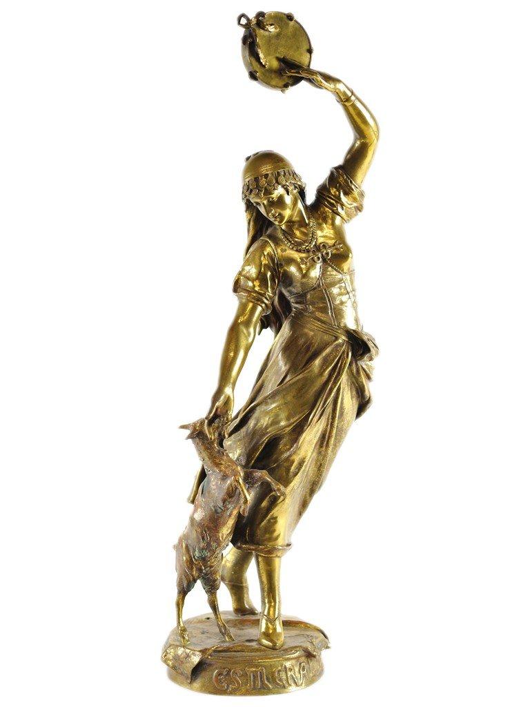 91: A BRONZE STATUE OF ESMERALDA WITH A TAMBURINE AND H