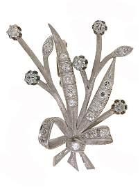 129: 14K DIAMOND FLORAL PIN