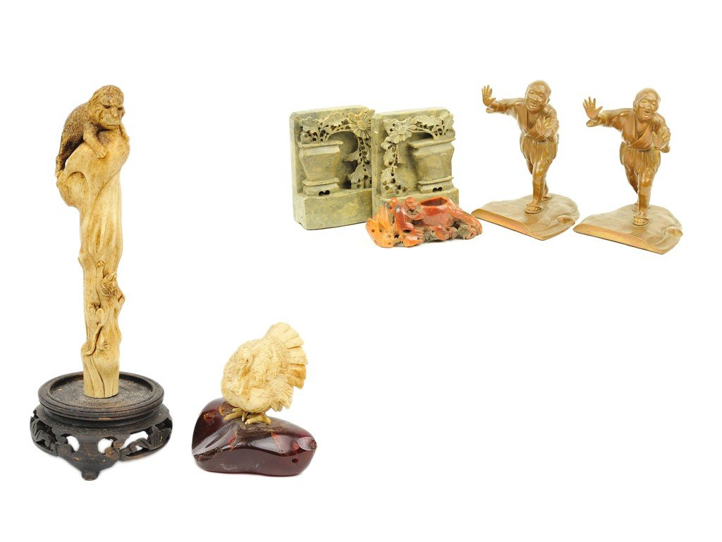 4: TWO PAIRS OF BOOKENDS AND ONE CARVED HARD STONE BRUS