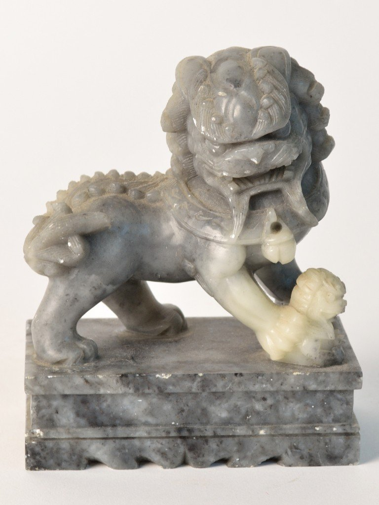 4: A HARDSTONE FIGURE OF A CHINESE FOO LION AND PUP