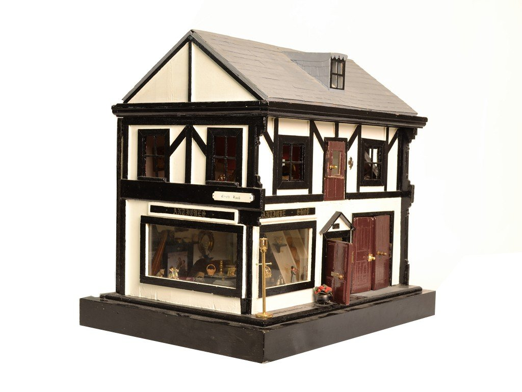 12: A DECORATIVE ANTIQUE SHOP FORM DOLL HOUSE Furnished