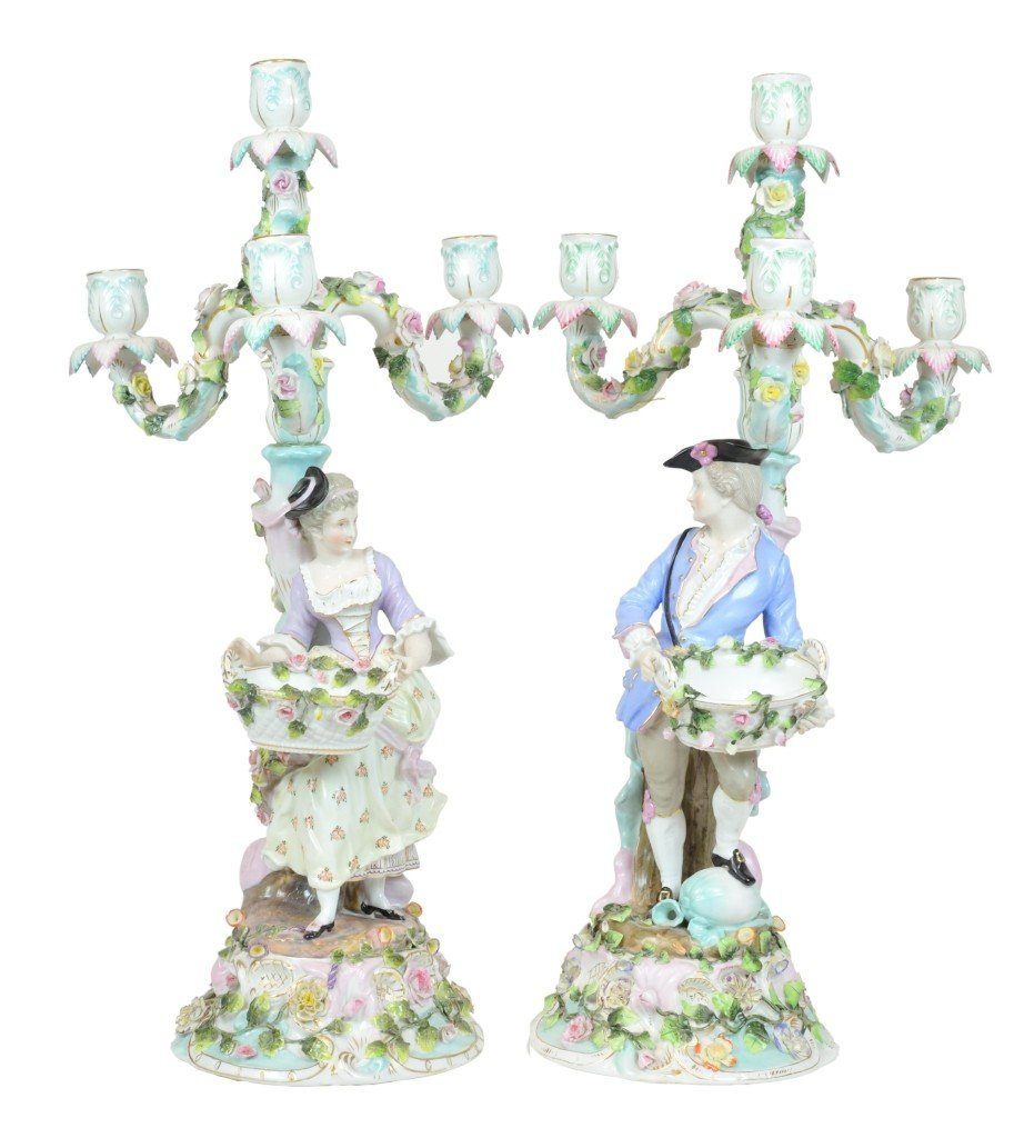 18: A PAIR OF GERMAN FIGURAL FORM FOUR-LIGHT CANDELABRA