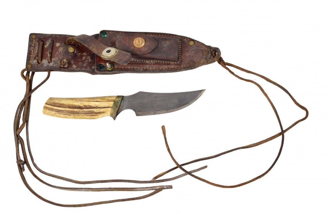 11: A RANDALL MADE KNIFE. LEATHER SCABBARD, HORN HILTS