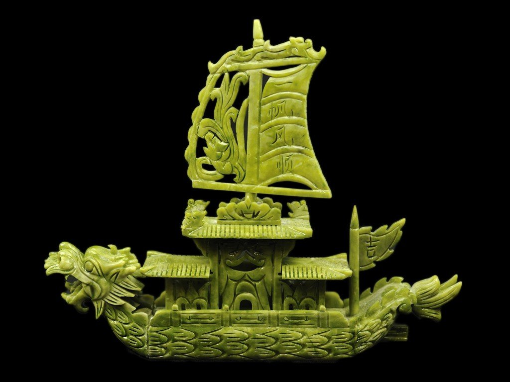 4: A CHINESE SOAPSTONE CARVED BOAT OF A DRAGON WITH A P