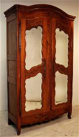 180: AN ANTIQUE FRENCH PROVINCIAL WALNUT TWO DOOR ARMOI