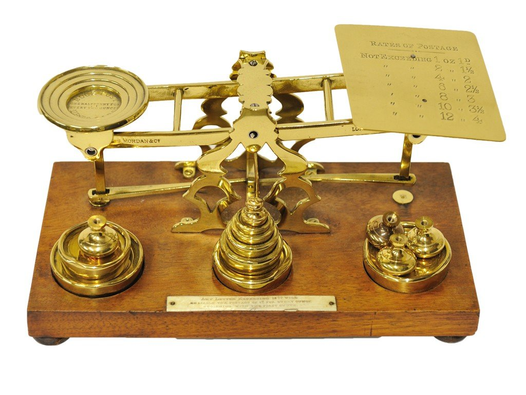 8: A RARE BRASS AND WOOD VINTAGE POSTAL SCALE WITH WEIG