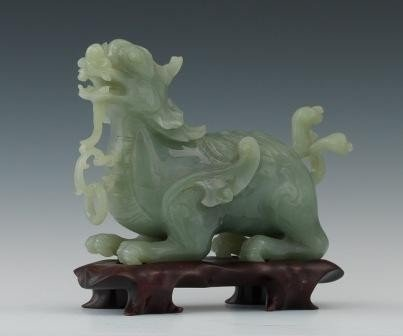 7A: A CHINESE CARVED JADE OR HARDSTONE DRAGON FIGURE