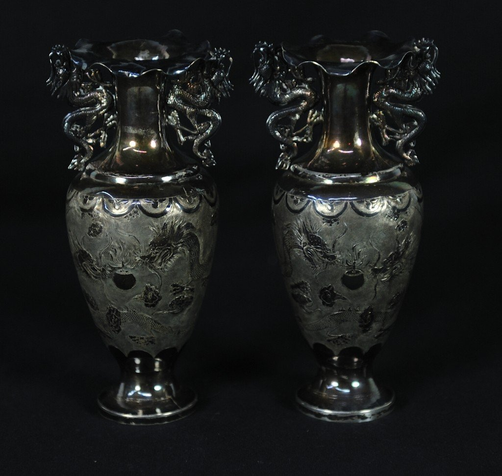 A PAIR OF ASIAN EXPORT SILVER VASES