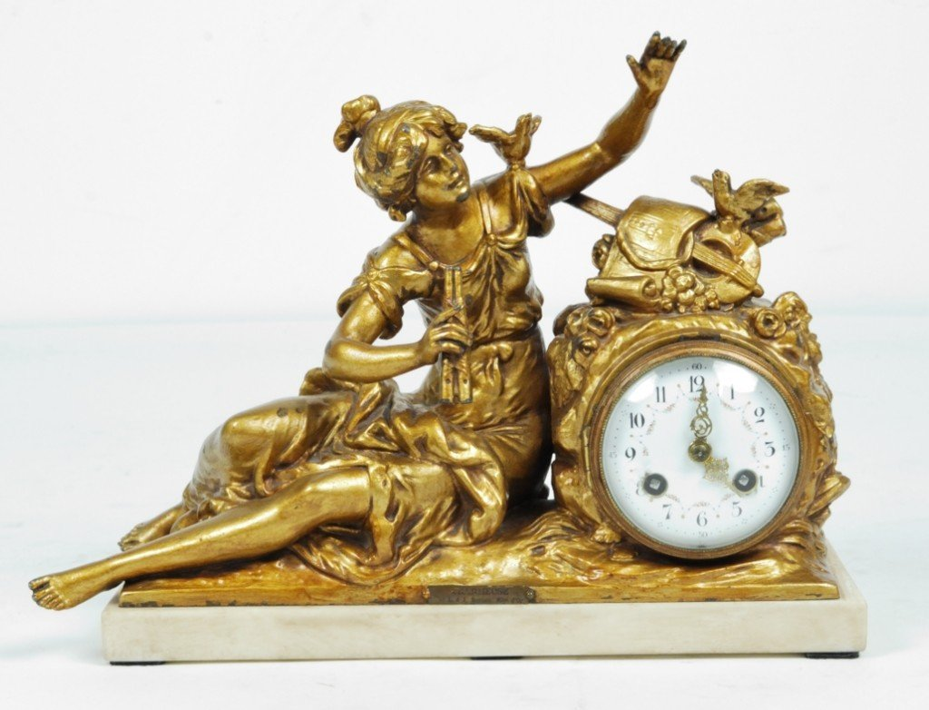 A VINTAGE SPELTER AND MARBLE MANTLE CLOCK