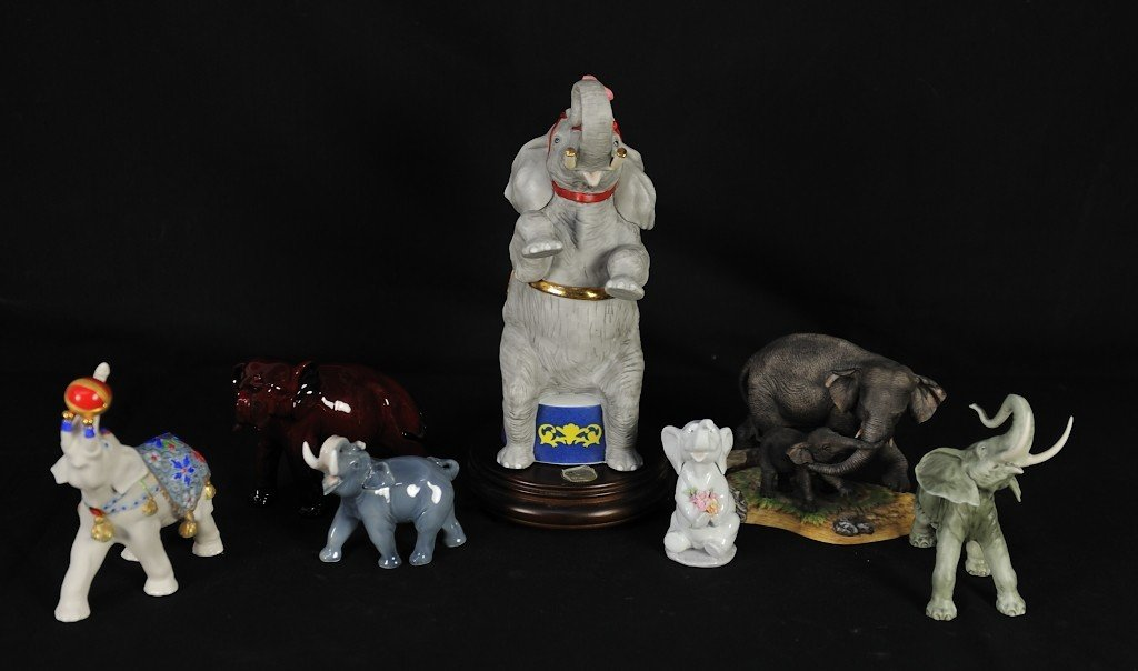 A GROUP OF SEVEN DECORATIVE ELEPHANT FIGURINES