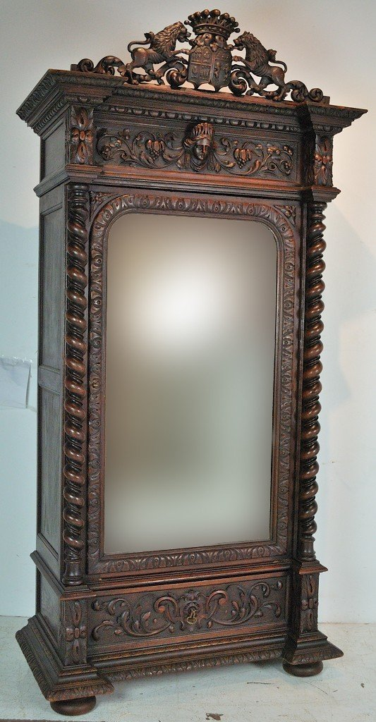 A RENAISSANCE REVIVAL HIGHLY ORNATE CARVED OAK ARMOIRE