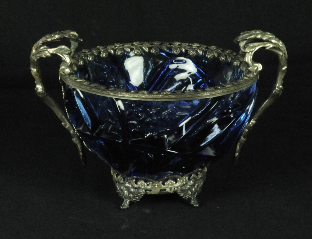 1: A DECORATIVE BLUE GLASS AND SILVERED METAL BOWL