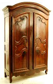 238: A LOUIS XV STYLE WALNUT DOUBLE DOOR ARMOIRE Late 1