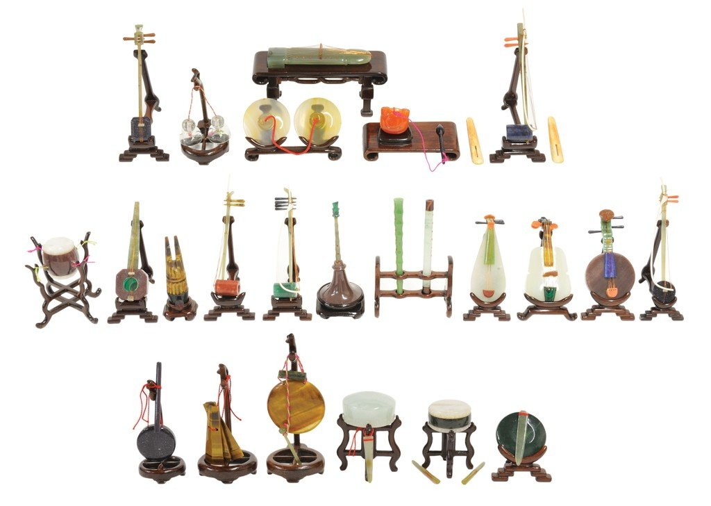 12: A GROUP OF TWENTY THREE CHINESE HAND CARVED MUSICAL