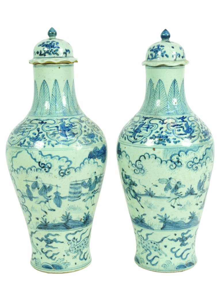 17: A PAIR OF LARGE BLUE AND WHITE POTTERY COVERED VASE