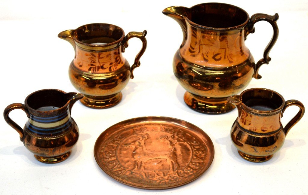 9: A GROUP OF FOUR LUSTRE PITCHERS AND ONE COPPER TRAY