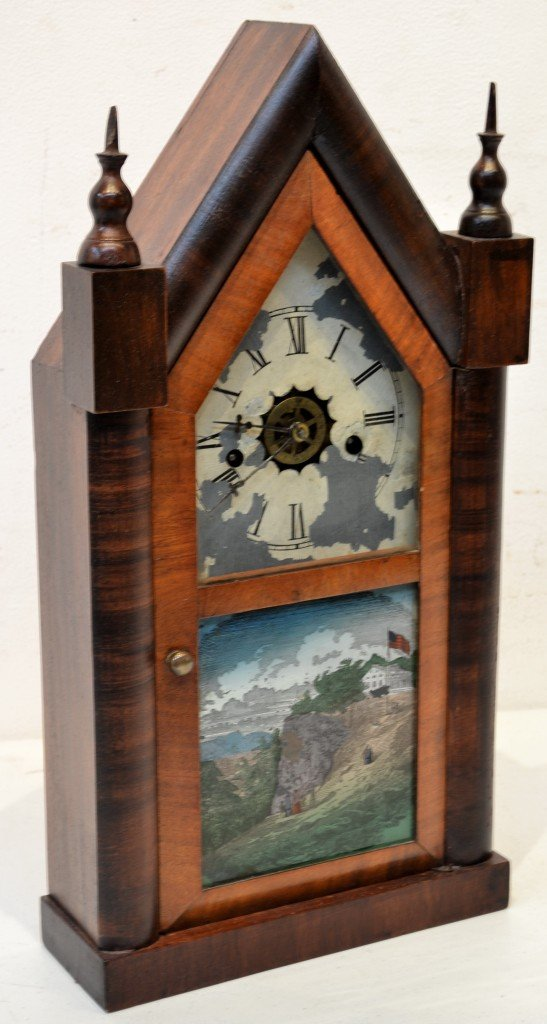 16: A 19th CENTURY CLOCK WITH REVERSE PAINTING