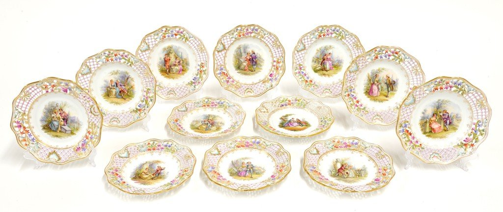 23: SET OF TWELVE DRESDEN GILDED AND DECORATED PORCELAI