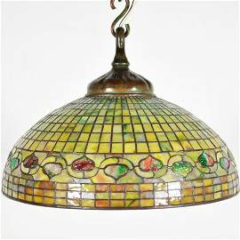 107: A STAINED GLASS AND BRONZE FIVE-LIGHT PENDANT LAMP