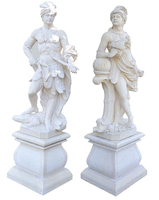 A PAIR OF EXOTIC EUROPEAN STATUES