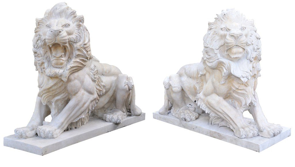 2: AN OPPOSING PAIR OF CROUCHING LIONS ON AN INTEGRATED