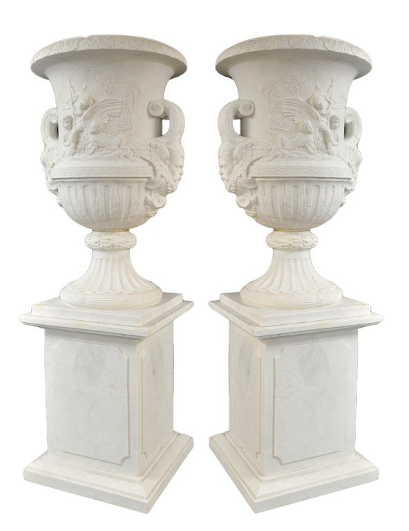 17: A PALATIAL PAIR OF URNS ON RECTANGULAR BASE