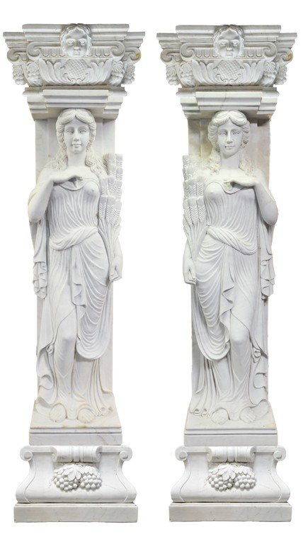 23: A PAIR OF DRAPED MAIDEN PILASTERS CARRYING SHOCKS O