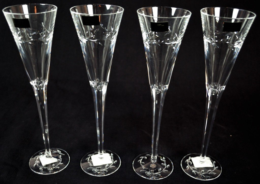 7: A SET OF 4 WATERFORD CHAMPAGNE FLUTES (MICHAEL ARAM)