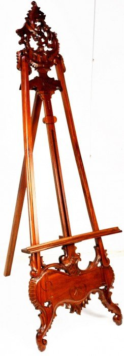 25: INTRICATELY CARVED WALNUT EASEL