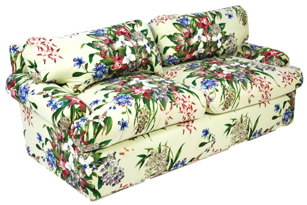 7: A FLORAL UPHOLSTERED TWO CUSHION SOFA