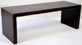 8: A TOBACCO FINISH LEATHER BENCH TABLE WITH BASEBALL S