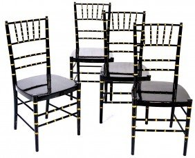 11: A SET OF FOUR BLACK ENAMELED AND GOLD TRIM FAUX BAM