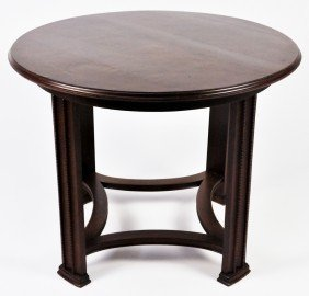 14: A ROUND ART AND CRAFT OAK TABLE