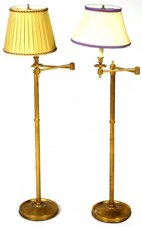 16: A PAIR OF BRUSHED BRASS SWING ARM FLOOR LAMPS
