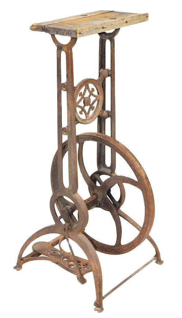 3: A 19TH CENTURY CAST IRON MACHINE STAND