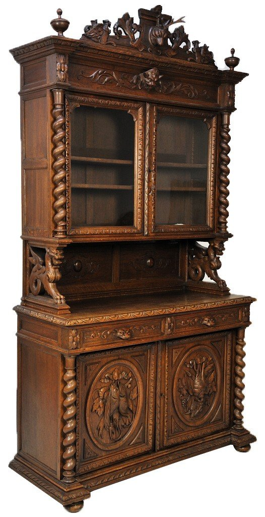12: A HENRI II STYLE OAK BUFFET WITH EXCEPTIONAL CARVIN