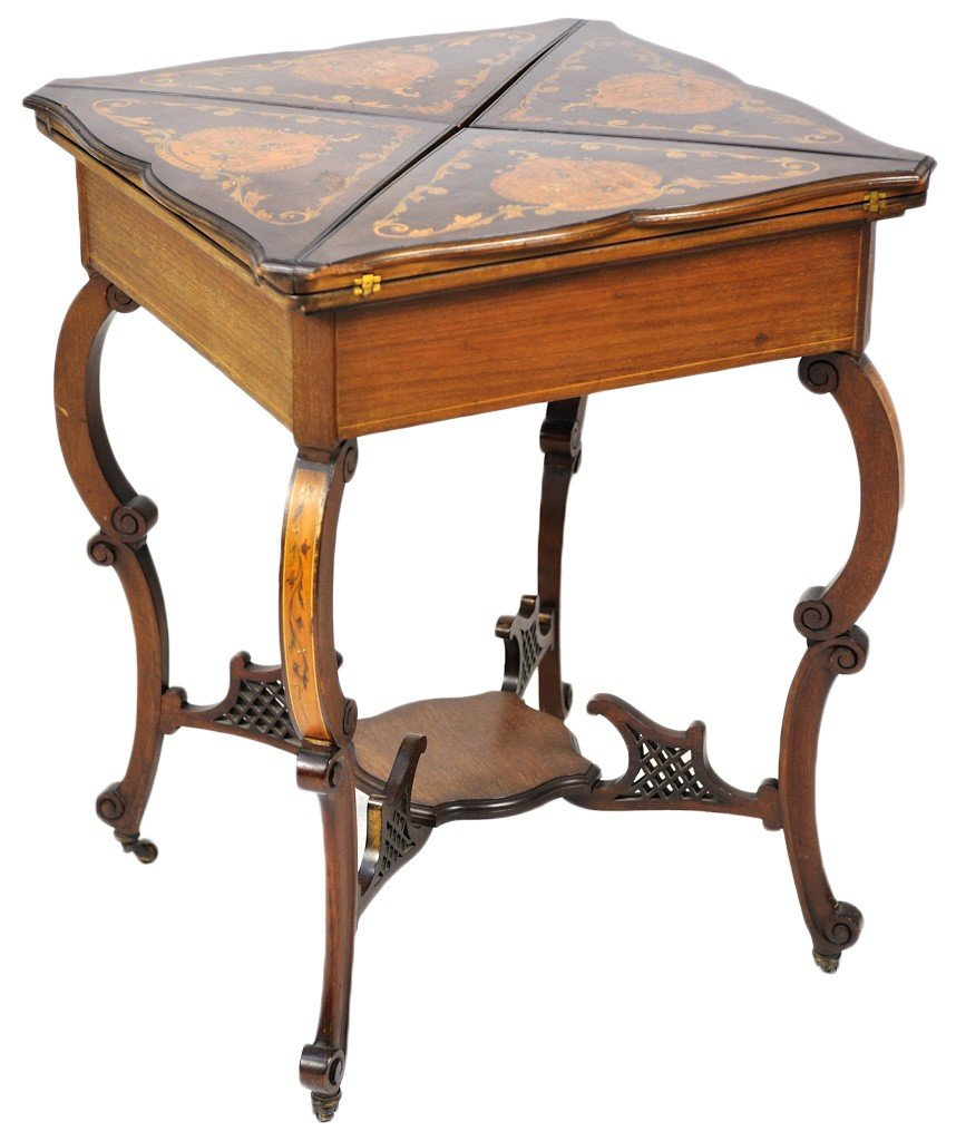 24: AN EDWARDIAN STYLE MAHOGANY GAME TABLE ON BRASS CAS