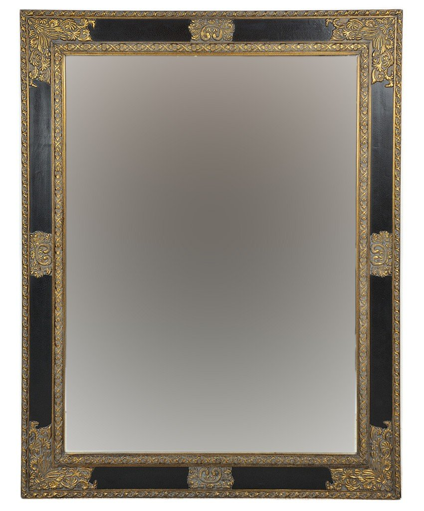 6: A LARGE LACQUER AND PARCEL FRAME BEVELED MIRROR